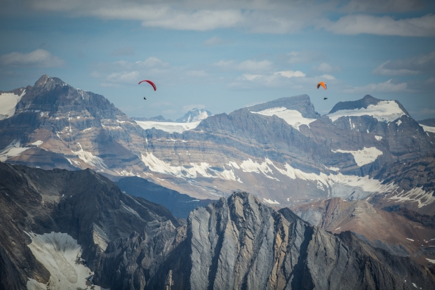 Flying across the Rocky Mountains with Will Gadd.  Photo Pablo Durana